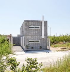 With Two Story Rectangular Construction, This Modern Concrete Block House  Has Rawness Exterior Because Of Low Budget Plan.
