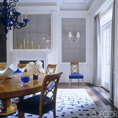 William Diamond and Anthony Baratta employed cobalt blue throughout the dining room of a Manhattan townhouse, from the Murano glass chandelier to the custom-made silk rug. The walls are covered in a velvet by Old World Weavers. - ELLEDecor.com