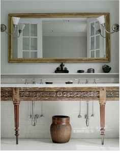 Carved Wood Bathroom Vanity via Monica Bach