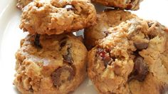 Breakfast cookies made with whole grains like rolled oats, flax meal, and whole wheat flour have the flavor of dried cherries and chocolate chips for a tasty breakfast on the run.
