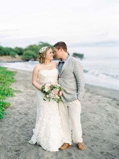 David's Bridal bride Emily in a lace strapless sweetheart fit & flare Oleg Cassini gown