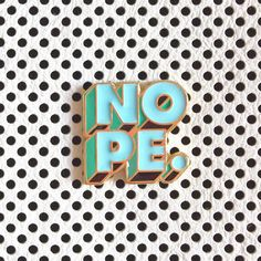 NOPE // Lapel pin badge of 3D lettering in blue with gold outlines by Ghost Goods Happy Feels Co.