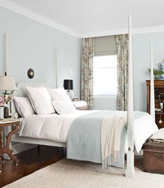Benjamin Moore's Ashmead Gray transformed this master bedroom's mahogany Henkel Harris four-poster. Custom drapes from Calico Corners add a hint of pattern, and an antique leather trunk provides extra storage. The duvet and shams are by Area.