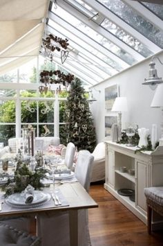 greenhouse style sun room with wood floors. sigh.