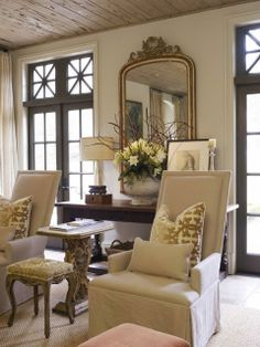 I really like the French doors painted a dark color, notice the trim around the doors is light