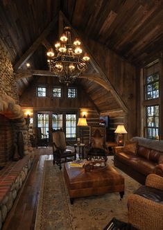 Mountain Cabin...get rid of the furniture and get some different colors in, but the wood and the stone fireplace are so clean.