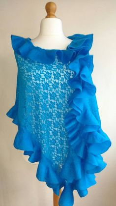 Beautifully designed luxury lace wrap shawl in Mediterrean blue color with matching ruffled edging by V&S Handmade. The wrap shawl is made of quality lace fabric and nuno felted with finest merino wool. It is very light and perfect for the evening.  The handmade piece is an amazing gift idea and a must have every womans accessory. It is nice for any occasion.  This outstanding luxury shawl is approx. 180cm (frills incl.) length and 60cm width.  Handwash only in lukewarm water, dry flat…