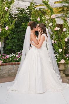 lesbian wedding kiss - Just Love this shot.  These two women are beautiful to do this.