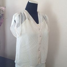 H&M Shear Top Feminine H&M button up, dotted, cream colored top. Featuring flowy cap sleeves, mother of pearl buttons, and ruched shoulders. 100% polyester. H&M size 6, fits small/medium.  No trades/PayPal. H&M Tops