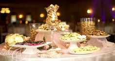 cookie-table-instead of a candy table at a wedding.  lovely idea