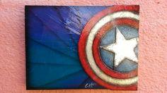 Escudo Capitan America realizado en mdf y aluminio. Pintura 100% original realizada por Chucho-Art. Medidas 35 x 45