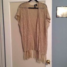 Crocheted Cover-Up Open crocheted short sleeved cover up. Longer. Comes down to the knees. Fringe detailing. Only worn once. In great condition. Size is medium, but honestly can fit up to any size and still look great! Bought at Tilly's Sweaters Shrugs & Ponchos