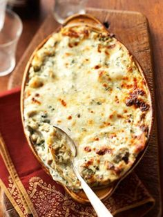 Creamy Artichoke Lasagne.  This recipe calls for fresh artichokes, another recipe suggests using two nine ounce packages of frozen (thawed and drained) artichokes.