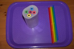Placing correctly colored straws into appropriate holes  (color matching, fine motor)