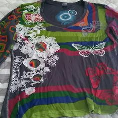 Desigual crew neckline shirt Soft 100%viscose,  vibrant colors and design,  xl but runs more like a large, bust 20', lenght 21.5', stretchy,  long sleeves, worn twice only, excellent condition. Desigual Tops Tees - Long Sleeve