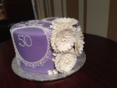 hand piped lace and filigree cake with sugar gerbera daisies to celebrate a 50th wedding anniversary!  White Rock BC Nut-free Bakery