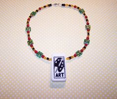 gorgeous beads and a reversible domino - one side ART, and one side 5/4!  Really cool design.