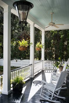 The first floor porch in the Lowcountry cottage that looks out on the dock. (Photo Credit: Imke Lass)