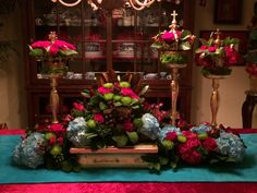 Live floral table decor coordinating with Nativity tree