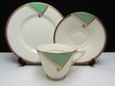 Doulton deco: Savona tea trio, c1930s. Green colourway - green geometric design with gold gilt scroll highlights and trim. Love, on my wishlist!