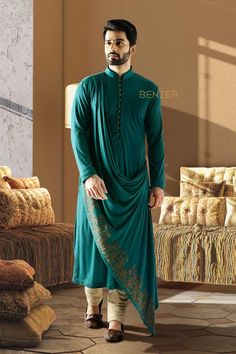 GREEN DRAPED KURTA A classy designer silhoutte for men ,we have the indo western look with this green hosiery stretch draped kurta.Team it up with trousers for the dapper look this wedding season. Sherwani For Men Wedding, Wedding Dresses Men Indian, Wedding Dress Men, Kurta Pajama Men, Kurta Men, Mens Sherwani, Gents Kurta Design, Boys Kurta Design, Indian Men Fashion