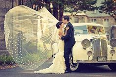 LOVE the wind-swept veil AND the amazing vintage car!