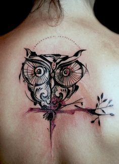 Owl design tattoo on back