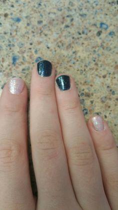 My nails  Black and blue glitter nail polish and    White glitter polish