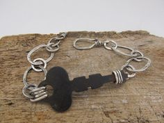 Skeleton key bracelet, hand fabricated in sterling silver with a real vintage steel skeleton key as the focal $55. by JoDeneMoneuseJewelry