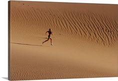 Girl running in desert