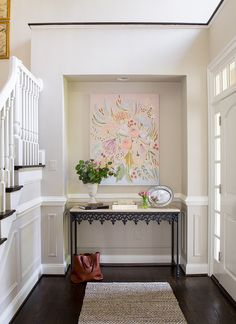 Family Home with Neutral Interiors. This beautiful foyer embraces the color palette that is found in the remaining rooms of this house. As you will notice, this home has soothing interiors with a very feminine approach.