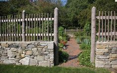 vegetable garden fence - stone and wood