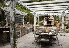 i would love to give dinner parties at this beautiful outdoor kitchen and dinning room.