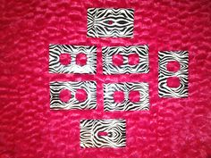 Outlet covers for my daughters bedroom using Zebra print duck tape!