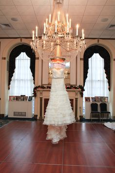 Wedding Dress Hung Under Chandelier | Pauleenanne Design | 13 One Photography