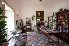 In Southern Sicily, a Baroque Retreat - The marble fireplace mantel, behind the table at center, is one of many imported from Paris.