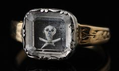 Rare gold mourning ring with a rectangular bezel set with a crystal covering a piece of dark hair with skull, painted in white. The hoop adorned with floral scrolls. price on application Ref: Charles Oman, British Rings Mourning Ring, Mourning Jewelry, Ancient Jewelry, Antique Jewelry, Vintage Jewelry, Victoria And Albert Museum, Crane, Memento Mori Ring, Stuffed Animals