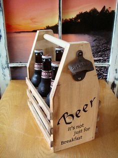 Custom made to hold a regular six pack of 12 oz bottles. Engraved with a CNC router. Light stain and oil finish.