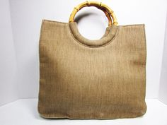 """Fossil Beige Tote Handbag Purse w/Rattan Handles Height/Depth 10""""Length 11""""Width 3""""Drop 4"""" Description: Nice tote by Fossil Color: Beige Material: Canvas Rattan handles Lined with pretty blue floral fabric One compartment, interior wall zippered pocket Measurements: Please see above Condition: in good used condition. Minor discoloration on front side, you have to look hard to notice this (see pic #8)It appears this bag used to have a strap, since it has hooks on the sides. Please note this…"""