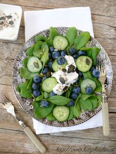 Spinach, blueberries and cucumbers with yogurt dressing