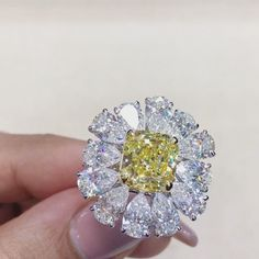 Mia Moon Jewellers Bahrain. Meet our breathtaking sunflower diamond ring, set with magical yellow diamond and spectacular pear-shaped diamonds.