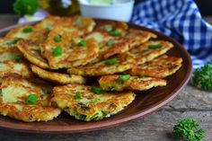 Cheesy Potato and Zucchini Fritters. Cheap and easy, and great for an easy dinner to make that still gets the kids to eat their vegetables!
