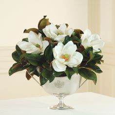 magnolia bloom silver vase  - simple and pretty.  maybe cocktail tables or to use for BM area?