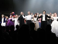 The Broadway cast of LES MISERABLES bows on opening night.
