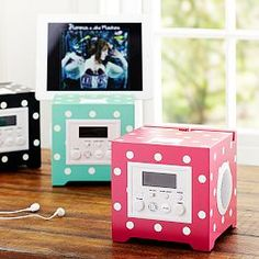 I have this and I love it. I have the blue one. It is a 4 in 1 clock. It has the time,speaker that plays music from any apple device,charges( Apple devices) and can be used as an alarm clock. You can find this on pottery barn teen<3