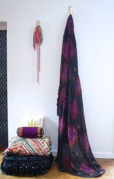 Use this stunning tribal fabric to create some African style! Use for curtains, canopies, table clothes, throws on beds, etc. Hand dyed in Mauritania. This fabric is branded with diamond shapes of black, purple and orange subtly interweaving. All cotton. Available at Maryam Montague's online Souk!
