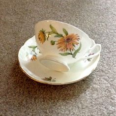 Regency English Bone China Teacup with a Yellow Black Eyed Susan Flower with Green Leaves! Pretty footed Tea Cup & Saucer! Gilded Gold trim on Cup and