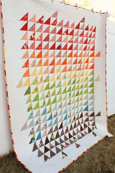 """Amy Smart used a rainbow of colorful fabrics to make this beautiful Spectrum Half Square Triangle Quilt. Here's what Amy had to say about her quilt and working with half square triangles: """"This is . Triangle Quilt Pattern, Half Square Triangle Quilts, Square Quilt, Scrap Quilt, Quilt Blocks, Quilting Projects, Quilting Designs, Sewing Projects, Quilting Ideas"""