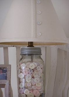 My mom has made these and filled them with dried beans and rice for the kitchen. Mason jar + buttons = lamp