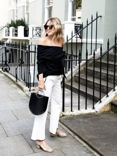 There's a reason a black-and-white look will work no matter the season—it's always chic and easy to pull off. For summer, we are taking notes from Lucy Williams of the blog Fashion Me Now and plan on trying her incredibly cool contrasting look by pairing a black off-the-shoulder top with cropped white trousers, and completing the outfit with a statement metal-handle bag and strappy nude sandals.
